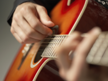 How to Restring an Electric Guitar That Has String Retainers